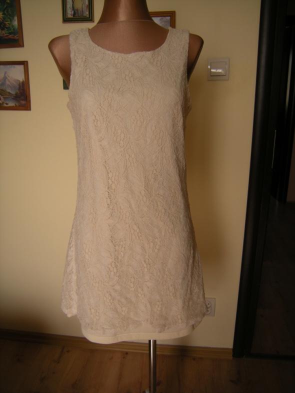 Koronkowa kremowa sukienka Reporter 38...
