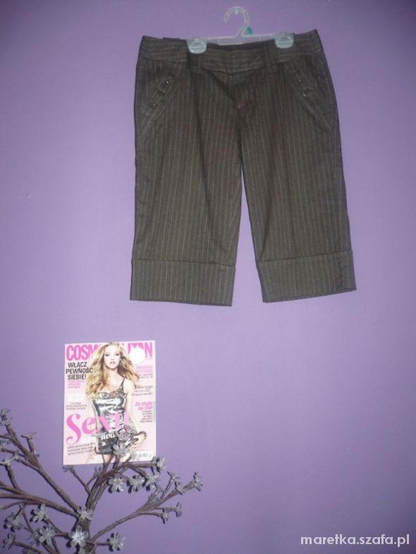 Spodnie 9...