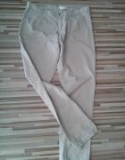 Spodnie rurki cygaretki jasne Camaieu...
