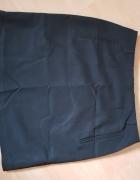 Krótka obcisła elegancka czarna spódnica...