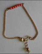 bransoletka w kolorze złotym