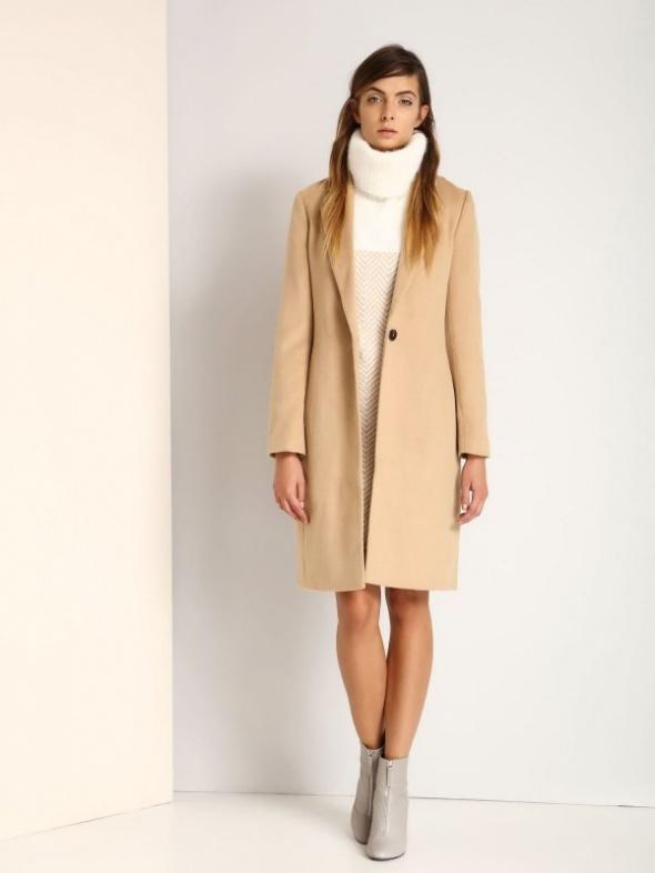 beżowy płaszcz damski...