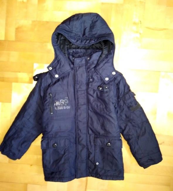 Granatowa ciepła kurtka dla chłopca 7 lat Next