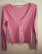 Różowy sweter Zara...