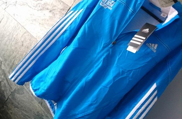 Błękitna kurtka Adidas Woman Running asymetryczna...