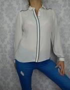 Biała elegancka koszula z lampasem...