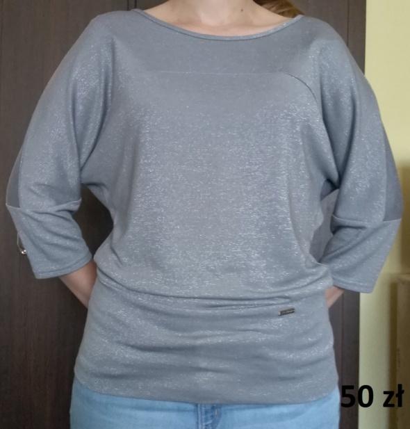 srebrna błyszcząca bluzka