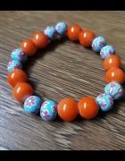 Bransoletka z pomarańczowo niebieskich koralików...