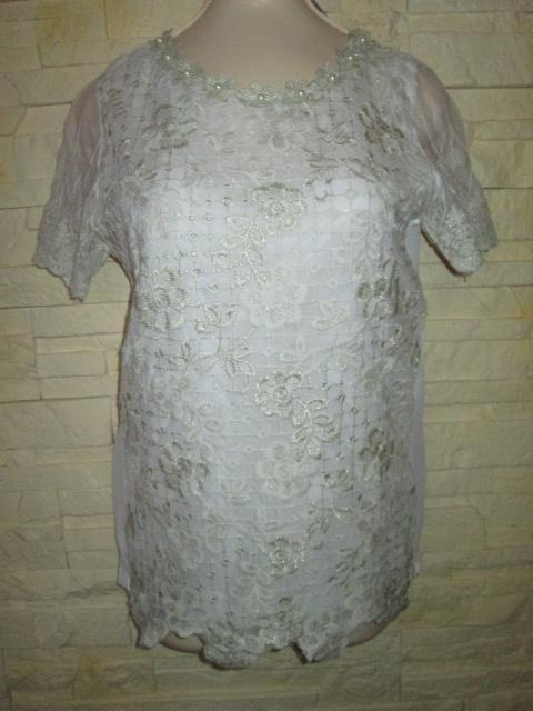 Bardzo elegancka haftowana bluzka z perełkami