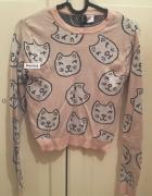 Słodki sweterek w kotki