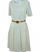 Elegancka sukienka rozkloszowana ze złoty paskiem