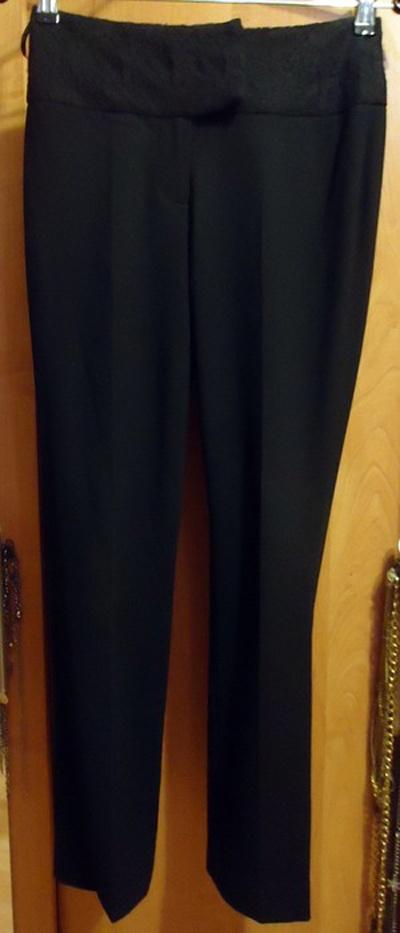 Czarne eleganckie dopasowane spodnie w kant rurki klasyczne Top...