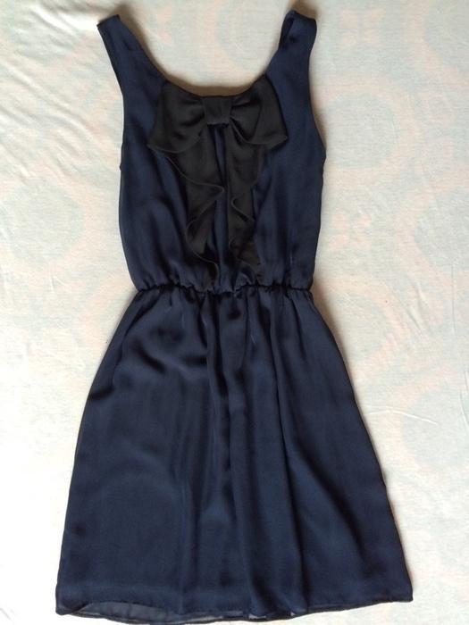 Elegancka sukienka z kokarda
