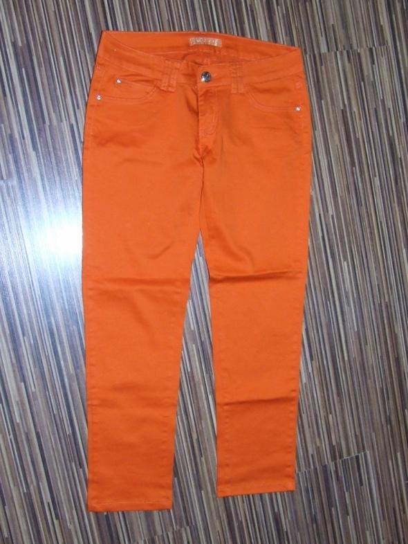 pomaranczowe spodnie Miss rozmiar XL...