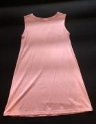 Trapezowa sukienka w kolorze jasnego różu...