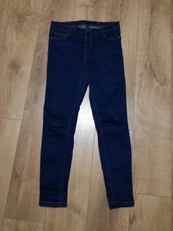 Spodnie spodnie jeans wysoki stan Reserved