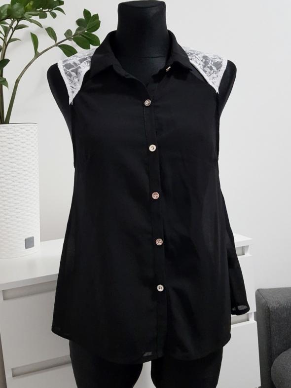 rozszerzana czarna bluzka mgiełka z białą koronką