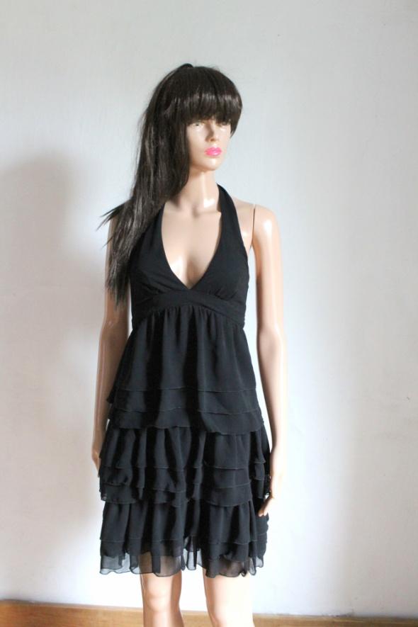 Czarna sukienka zapinana na szyi falbanki r XS...