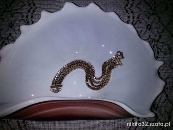 Prześliczna bransoletka avon w kolorze złotym...