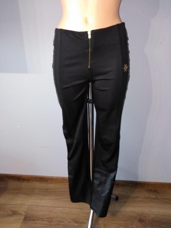 Czarne legginsy ze wstawkami z eko skóry...