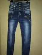 Granatowe jeansy rurki wysoki stan ćwieki suwaki 34...