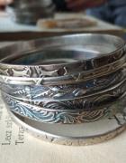 stare srebrne bransoletki Warmet Rytosztuka koła koziołki liść akantu