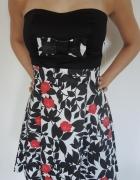 Rozkloszowana sukienka w kwiaty z kokardką NOWA