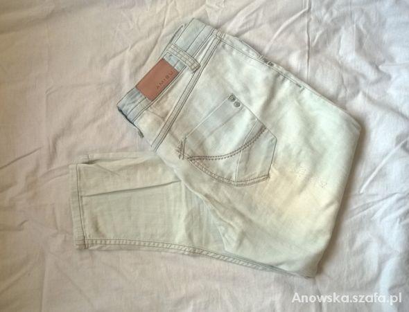 Białe jeansowe rurki rybaczki