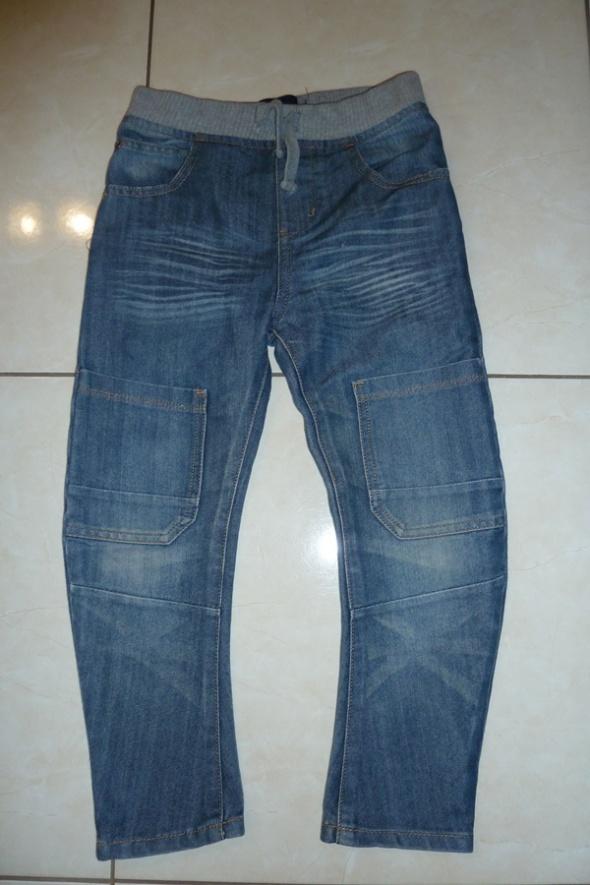 spodnie jeans krzywe 128