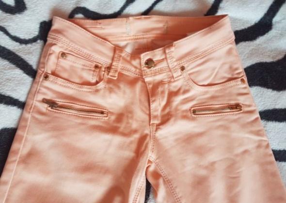 Spodnie rurki jeansy zipy złote elementy koral xs