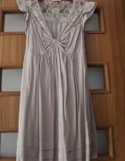 Sukienkatunika z koronkowymi wstawkami...