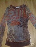 Delikatna bluzeczka znapisami r38...