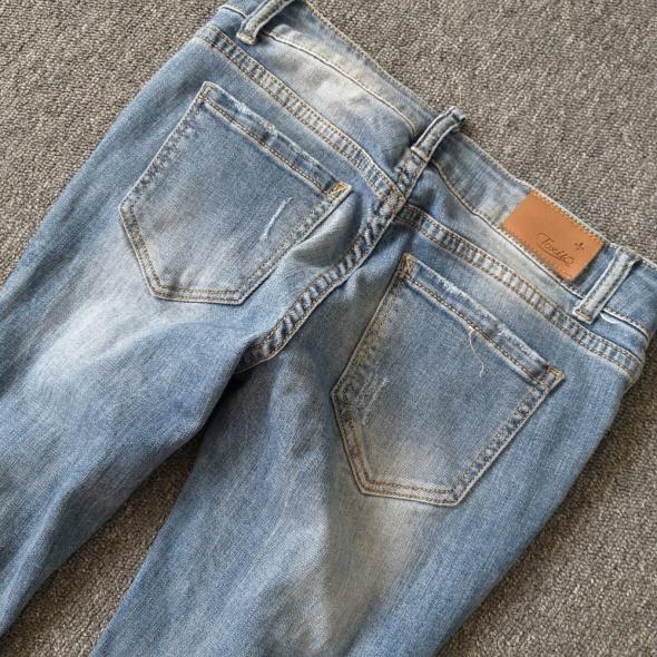 Spodnie z dziurami Toxik S