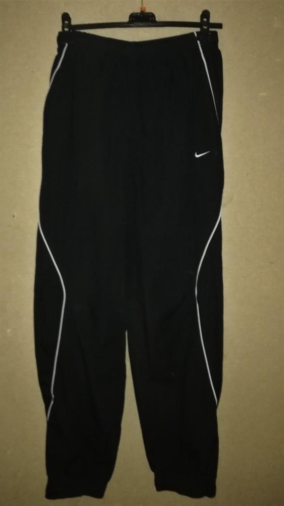Nike Czarne spodnie sportowe dresy ściągacze M