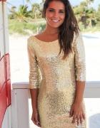 Elegancka złota sukienka z cekinami...