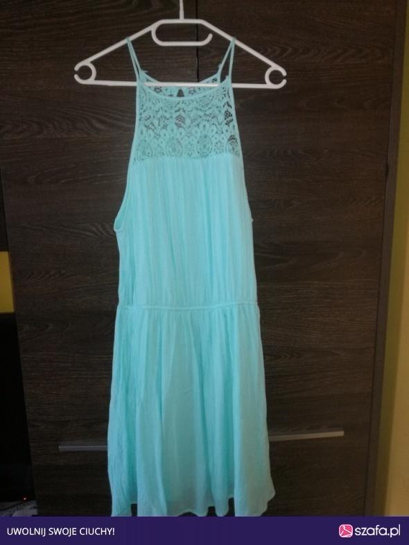 Błękitna sukienka M L