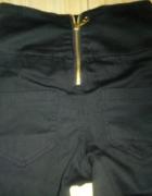 Eleganckie spodnie z wysokim stanem r 32...
