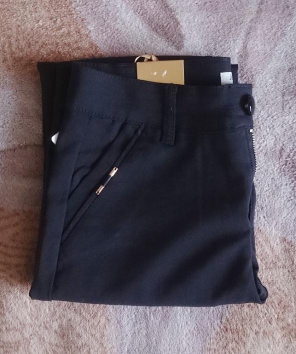 Czarne spodnie wysoki stan do kostek Hit Tanio