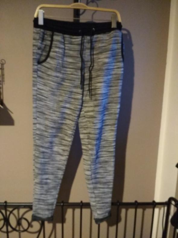 Dresowe spodnie rurki szare melanż esmara XS