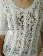 Pleciony biały sweter warkocz...