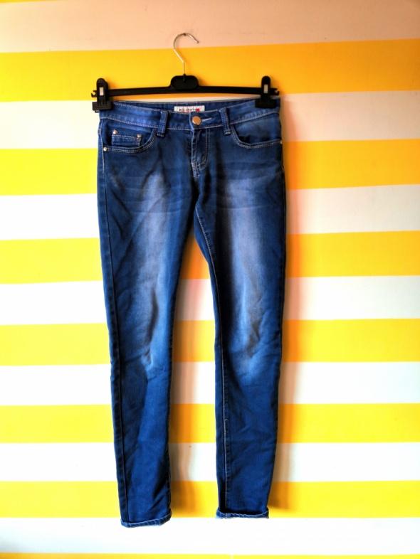 Niebieskie jeansowe spodnie dopasowane slim S