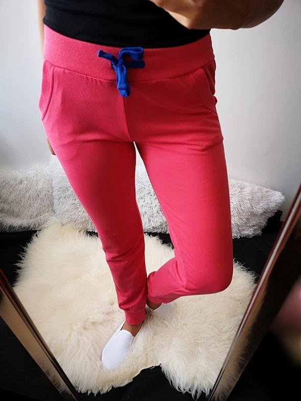 Spodnie dresowe damskie róż L XL
