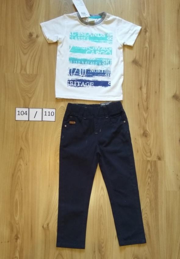 Granatowe wyjściowe spodnie i biała bluzeczka krótki rękaw 104 110