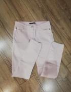 Spodnie jeans rurki pudrowy róż S...
