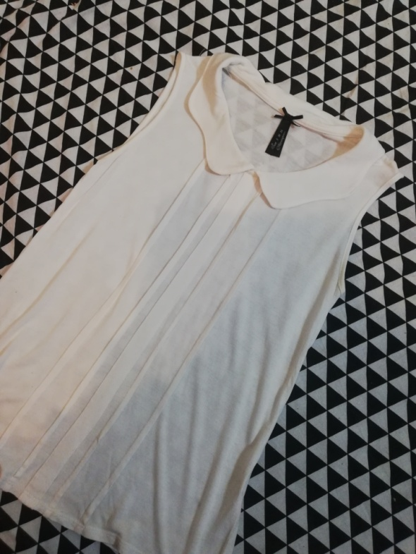 Elegancka biała bluzeczka z kołnierzykiem...
