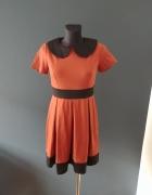 Rozkloszowana sukienka w kolorze rudym