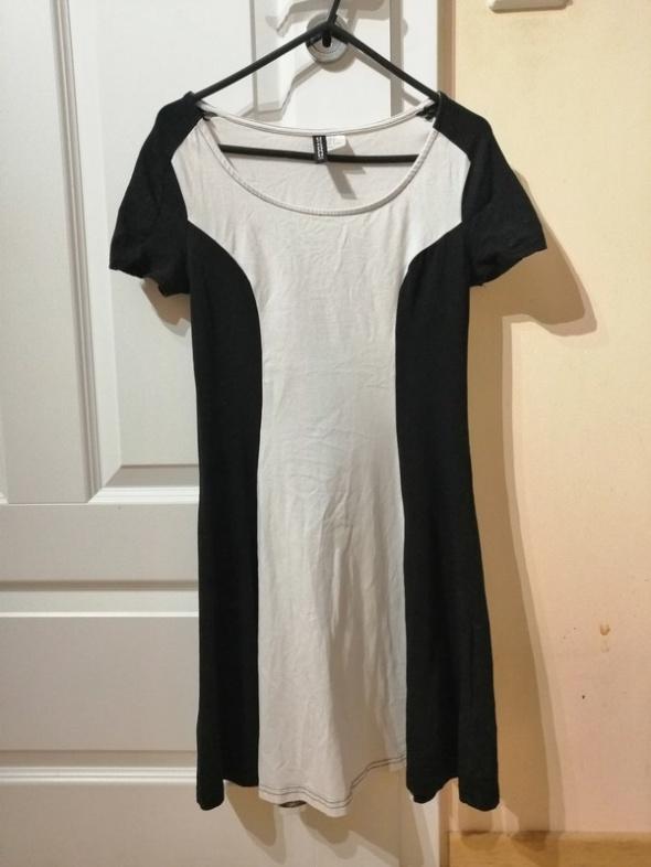3b0e7e04a6 Suknie i sukienki Czarno biała rozkloszowana sukienka H M pasy divided