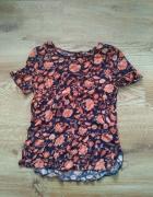 Czarna bluzka w pomarańczowe wzory 36...
