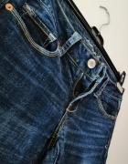 Granatowe jeansy American Eagle 26 30 dzwony...