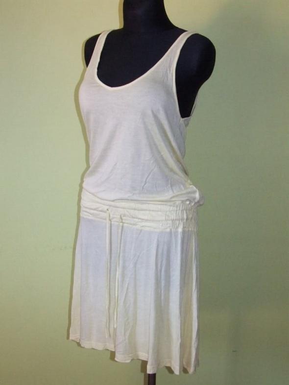 zolta sukienka H&M rozmiar 38...